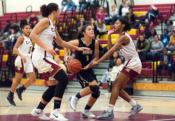 12/10/18 Wesley Bunnell | Staff New Britain girls basketball was defeated 52-39 at home against Newington on Thursday evening. Brianna Clark (32) and Jada Hubbard (13) double team Sabrina Soler (1) as she drives to the basket.
