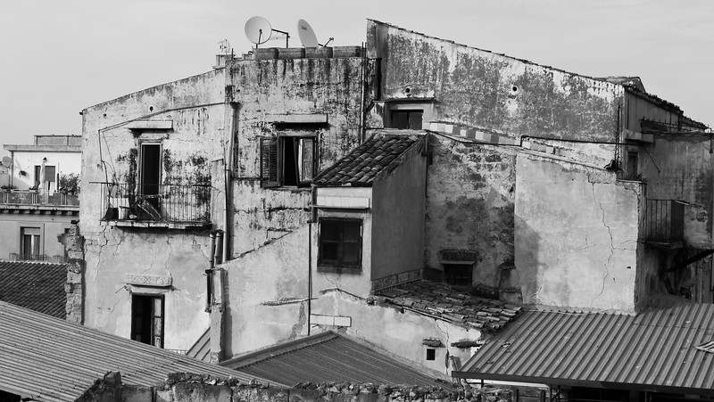 Dishes on old bulding in Palermo Sicily