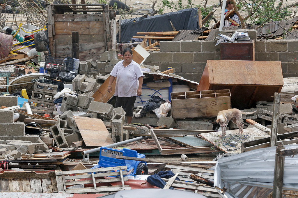 . A woman looks at what remains of her house after it was destroyed by Hurricane Odile in Los Cabos, Mexico,  Monday, Sept. 15, 2014.  (AP Photo/Victor R. Caivano)