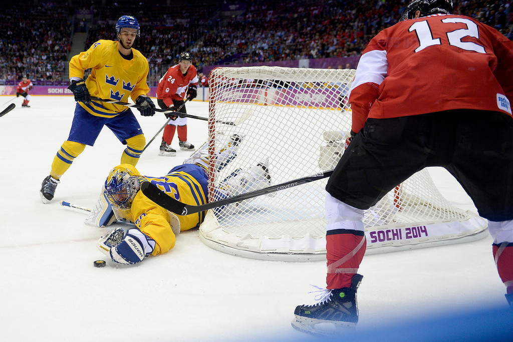 . Henrik Lundqvist (30) of Sweden stops a shot by Patrick Marleau (12) of Canada during the first period of the men\'s ice hockey gold medal game. Sochi 2014 Winter Olympics on Sunday, February 23, 2014 at Bolshoy Ice Arena. (Photo by AAron Ontiveroz/ The Denver Post)
