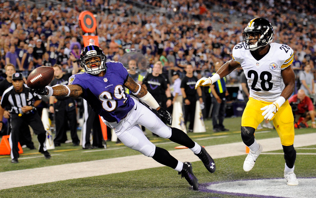 . Baltimore Ravens wide receiver Steve Smith (89) gets a hand on, but does not catch, a pass as Pittsburgh Steelers cornerback Cortez Allen (28) defends during the first half of an NFL football game Thursday, Sept. 11, 2014, in Baltimore. (AP Photo/Nick Wass)
