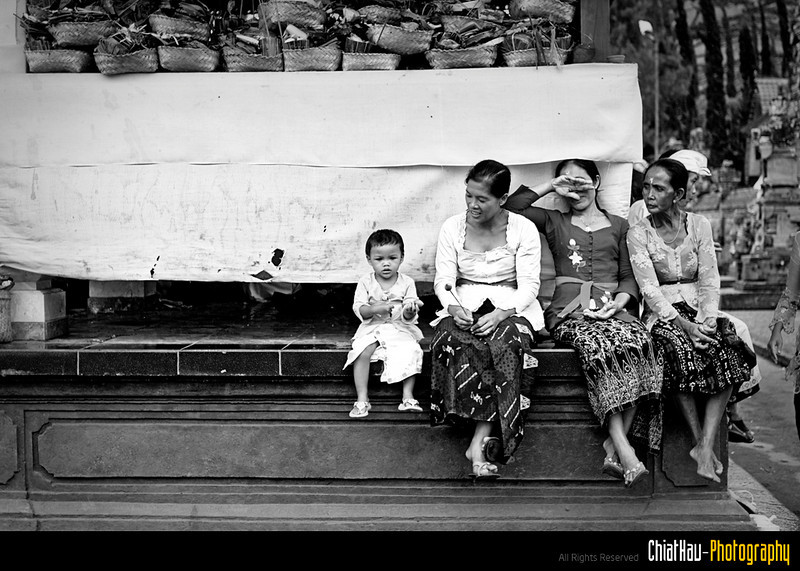 """The whole family is waiting for to perform their offering. I think one of them noticed me and trying to avoid the camera... :""""P (Sorry 35mm just not enough for some telephoto shot) :""""P"""