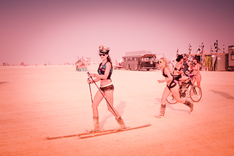 girl-skiiing-across-the-playa-burning-man-2013.jpg