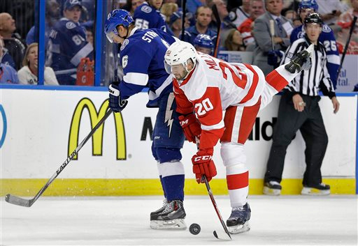 . Tampa Bay Lightning defenseman Anton Stralman (6), of Sweden, checks Detroit Red Wings left wing Drew Miller (20) during the first period of Game 1 of an NHL hockey first-round playoff series Thursday, April 16, 2015, in Tampa, Fla. (AP Photo/Chris O\'Meara)