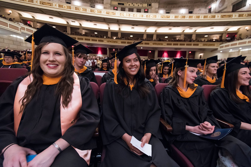 graduates smile as Celia Rose Freida delivers Undergraduate remarks for the class of 2019. // University of Rochester School of Nursing Commencement, Kodak Hall at Eastman Theatre May 17, 2019.  // photo by J. Adam Fenster / University of Rochester