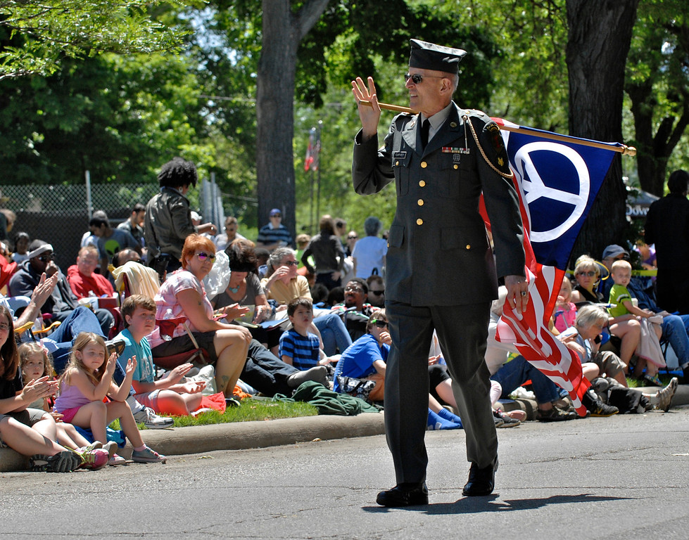 . Jeff Forman/JForman@News-Herald.com Army veteran Lou Pumphrey, of Painesville, walks around Wade Oval with an American Peace Flag prior to the Cleveland Museum of Art 25th annual Parade the Circle June 14 in University Circle.