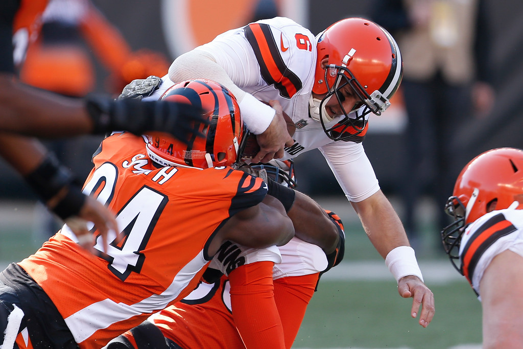 . Cleveland Browns quarterback Cody Kessler (6) is sacked by Cincinnati Bengals defensive end Chris Smith (94) in the first half of an NFL football game, Sunday, Nov. 26, 2017, in Cincinnati. (AP Photo/Gary Landers)