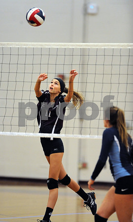 10/18/2017 Mike Orazzi | Staff Bristol Central's Emily Ericson (11) during Wednesday's volleyball match with Middletown at BC.