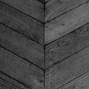 Ancient herringbone patterned wood flooring in apartment bulding stairway, Paris 11eme