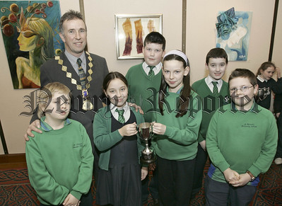 Newry Lions Club Sponsored swim awards. President William Hanna presents the 3rd best urban school St Ronans P.S. with theit trophy. 06W7N11