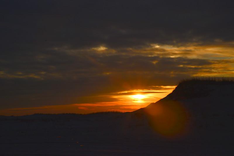 Sunset glare on dunes.JPG