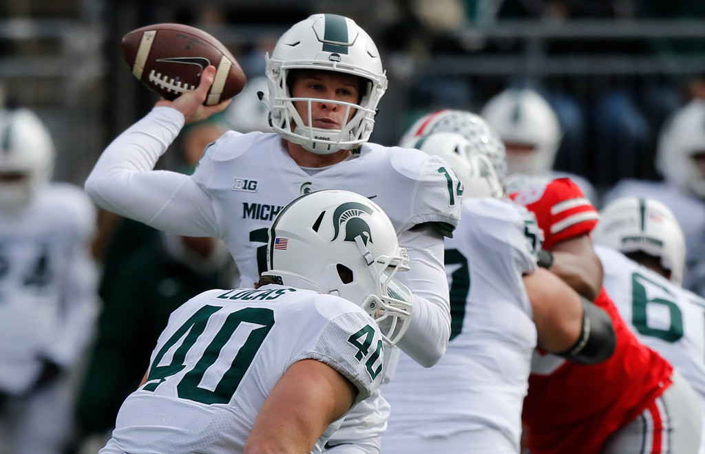 . Michigan State quarterback Brian Lewerke throws a pass against Ohio State during the first half of an NCAA college football game Saturday, Nov. 11, 2017, in Columbus, Ohio. (AP Photo/Jay LaPrete)