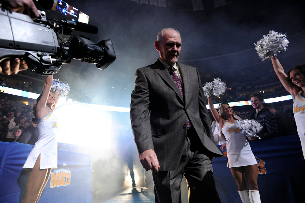 . Denver Nuggets head coach George Karl enters before the first quarter of the Nuggets\' home opener at the Pepsi Center on Wednesday, December 28, 2011 John Leyba, The Denver Post