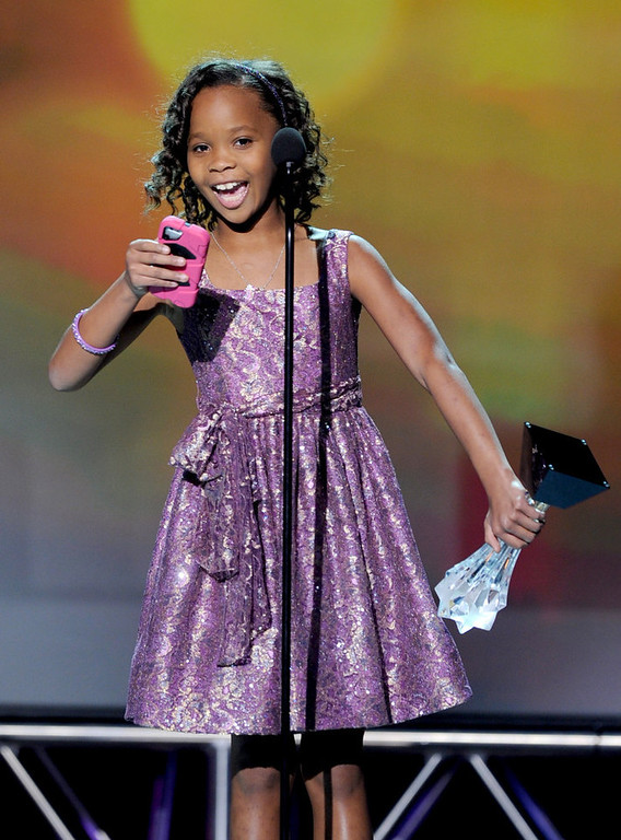 """. Actress Quvenzhane Wallis accepts the Best Young Actress Award for \""""Beasts of the Southern Wild\"""" onstage at the 18th Annual Critics\' Choice Movie Awards held at Barker Hangar on January 10, 2013 in Santa Monica, California.  (Photo by Kevin Winter/Getty Images)"""