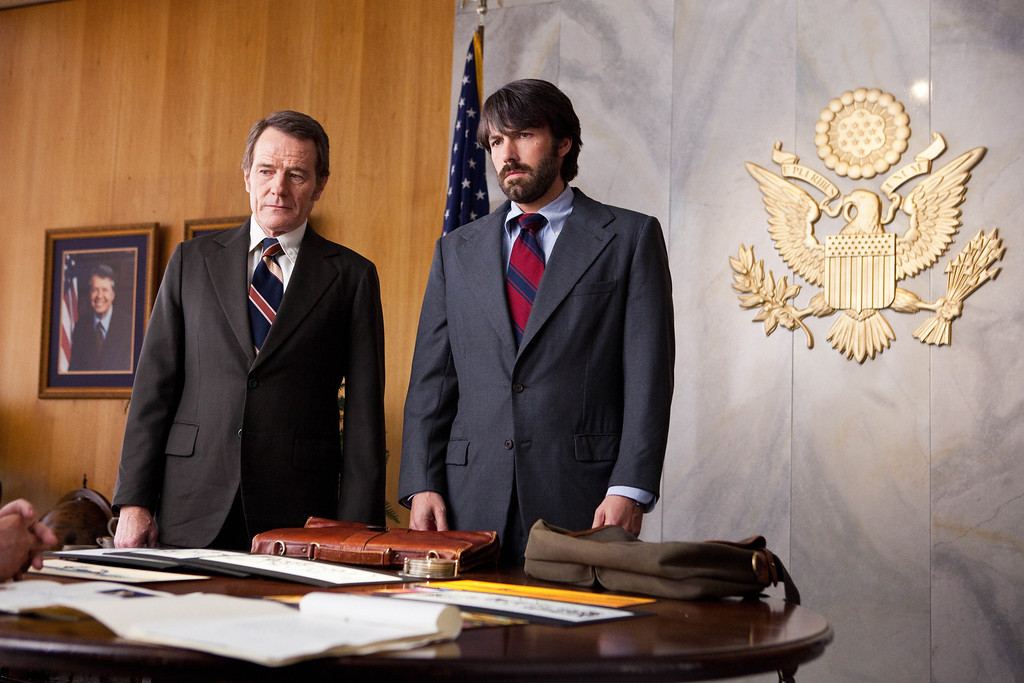 """. FILE - This undated publicity film image released by Warner Bros. Pictures shows Bryan Cranston, left, as Jack OíDonnell and Ben Affleck as Tony Mendez in \""""Argo,\""""  a rescue thriller about the 1979 Iranian hostage crisis.    (AP Photo/Warner Bros., Claire Folger, File)"""