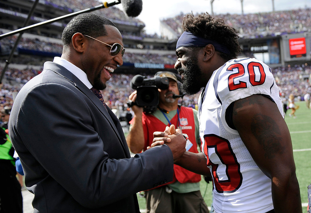 . Former Baltimore Ravens linebacker Ray Lewis, left, and Houston Texans free safety Ed Reed chat during halftime of an NFL football game between the Ravens and the Texans Sunday, Sept. 22, 2013, in Baltimore. (AP Photo/Nick Wass)