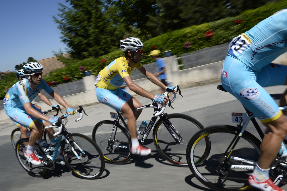 . Italy\'s Vincenzo Nibali (C) rides in the pack with his Kazakhstan\'s Astana teammates during the 185.5 km twelfth stage of the 101st edition of the Tour de France cycling race on July 17, 2014 between Bourg-en-Bresse and Saint-Etienne, central eastern France.  (LIONEL BONAVENTURE/AFP/Getty Images)