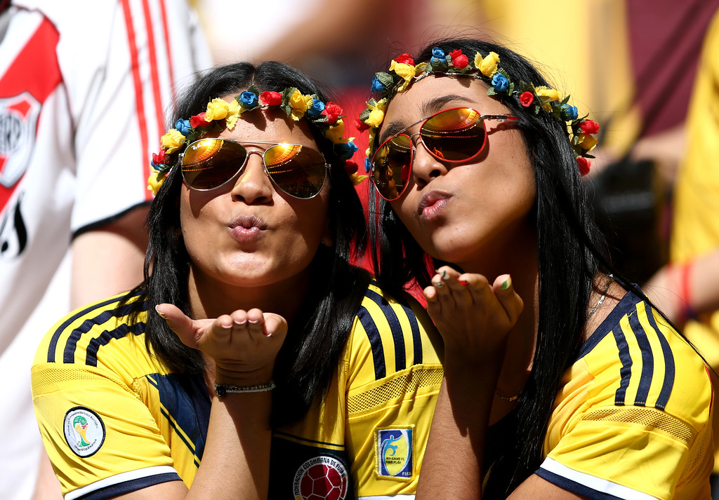 . Colombia fans enjoy the atmosphere during the 2014 FIFA World Cup Brazil Group C match between Colombia and Cote D\'Ivoire at Estadio Nacional on June 19, 2014 in Brasilia, Brazil.  (Photo by Warren Little/Getty Images)