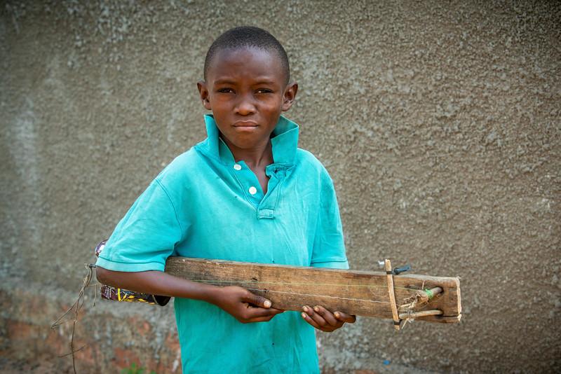 Boy with homemade guitar, at Nganza Child Friendly Space, Kananga, DRC.