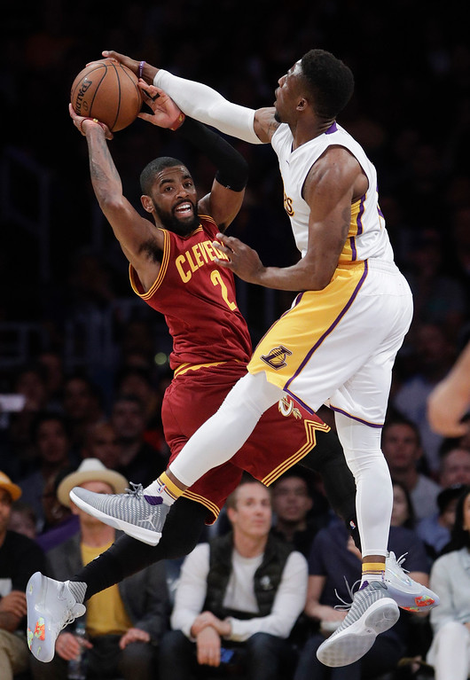. Cleveland Cavaliers\' Kyrie Irving, left, has his pass blocked by Los Angeles Lakers\' David Nwaba during the first half of an NBA basketball game Sunday, March 19, 2017, in Los Angeles. (AP Photo/Jae C. Hong)