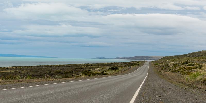 Empty road passing through coast, Santa Cruz Province, Patagonia, Argentina