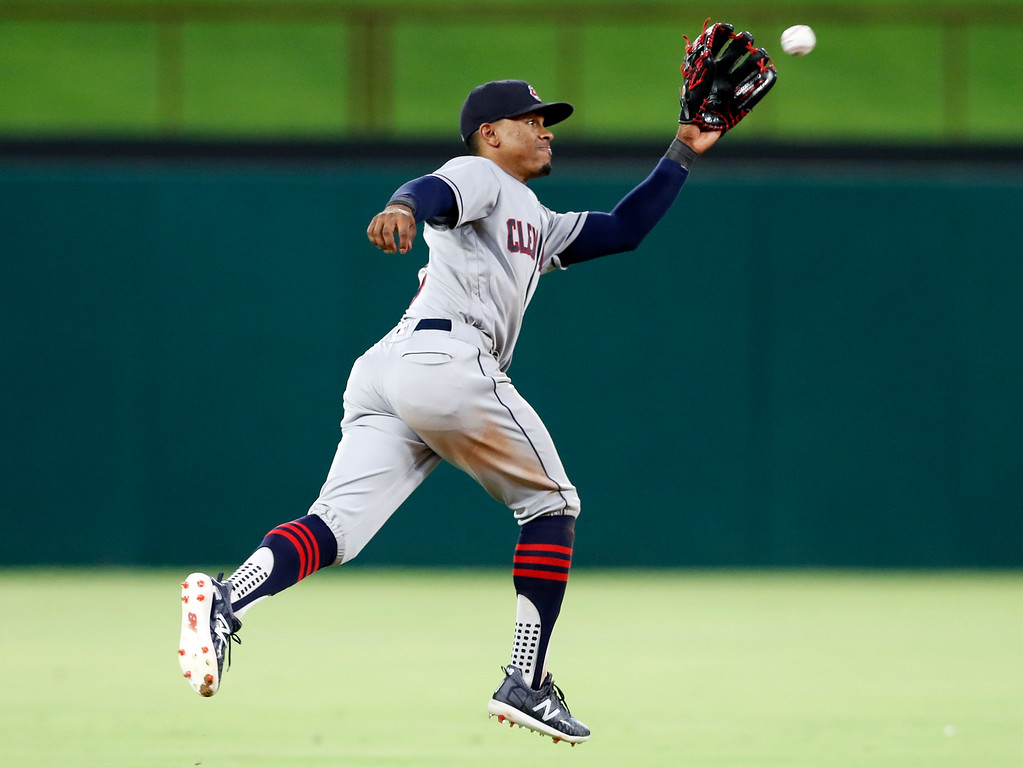 . Cleveland Indians shortstop Francisco Lindor catches a line drive hit by Texas Rangers\' Adrian Beltre during the fourth inning of a baseball game Friday, July 20, 2018, in Arlington, Texas. (AP Photo/Jim Cowsert)