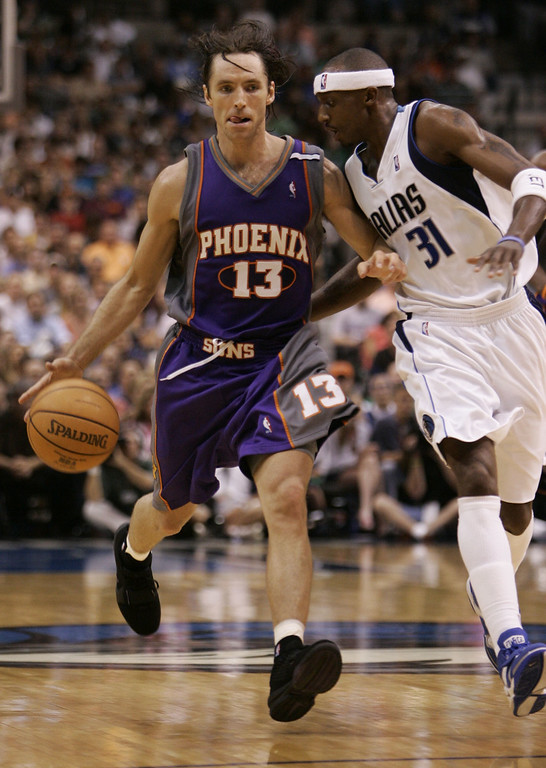 . Phoenix Suns guard Steve Nash of Canada works the ball around Dallas Mavericks guard Jason Terry (31) in the second half in Game 6  of their Western Conference semifinal series in Dallas, Friday, May 20, 2005. (AP Photo/Tim Sharp)