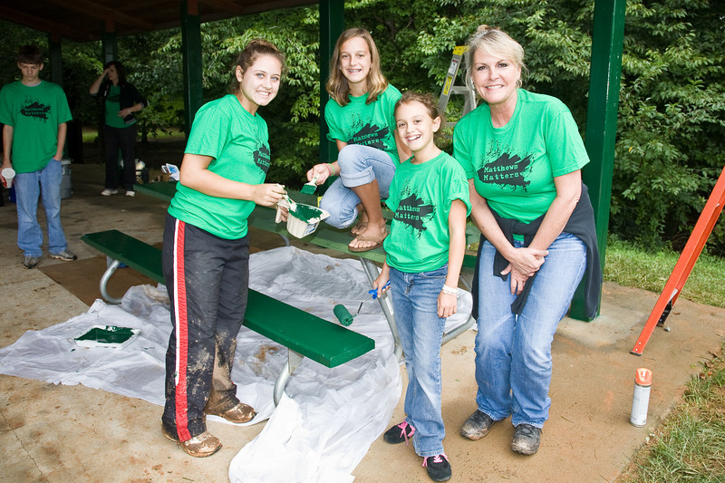 (left to right) Mariyn Nations, Alex Rousseaux, Maddy Rousseaux and Jan Shope paint a park bench.