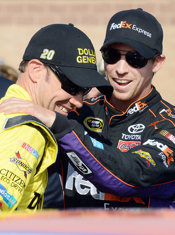 . BS23-NASACARFONTANA-069-WL (Will Lester/Staff Photographer) NASCAR driver Denny Hamlin (right) shares a laugh with Matt Kenseth after Hamlin\'s pole winning run for Sunday\'s Auto Club 400 Friday March 22, 2013. Hamlin lapped the 2-mile super speedway in 38.410 seconds at an average speed of 187.451mph.