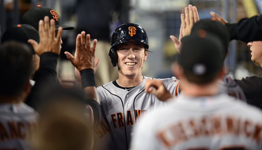 . Giants\' pitcher Tim Lincecum #55 enters the dugout after scoring in the 3rd inning during their game against the Dodgers at Dodgers Stadium Saturday, September 14, 2013. (Photo by Hans Gutknecht/Los Angeles Daily News)