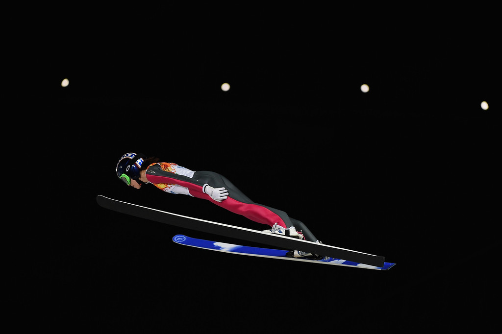. Sarah Hendrickson of the United States soars through the air during the Ladies\' Normal Hill Individual trial on day 4 of the Sochi 2014 Winter Olympics at the RusSki Gorki Ski Jumping Center on February 11, 2014 in Sochi, Russia.  (Photo by Lars Baron/Getty Images)