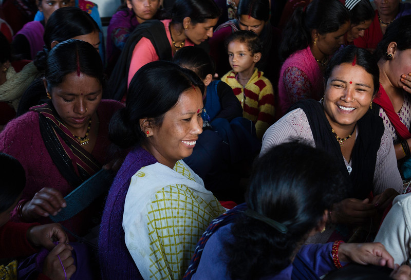 Women meet in a weekly meeting for the allotment of work and discuss their work issues