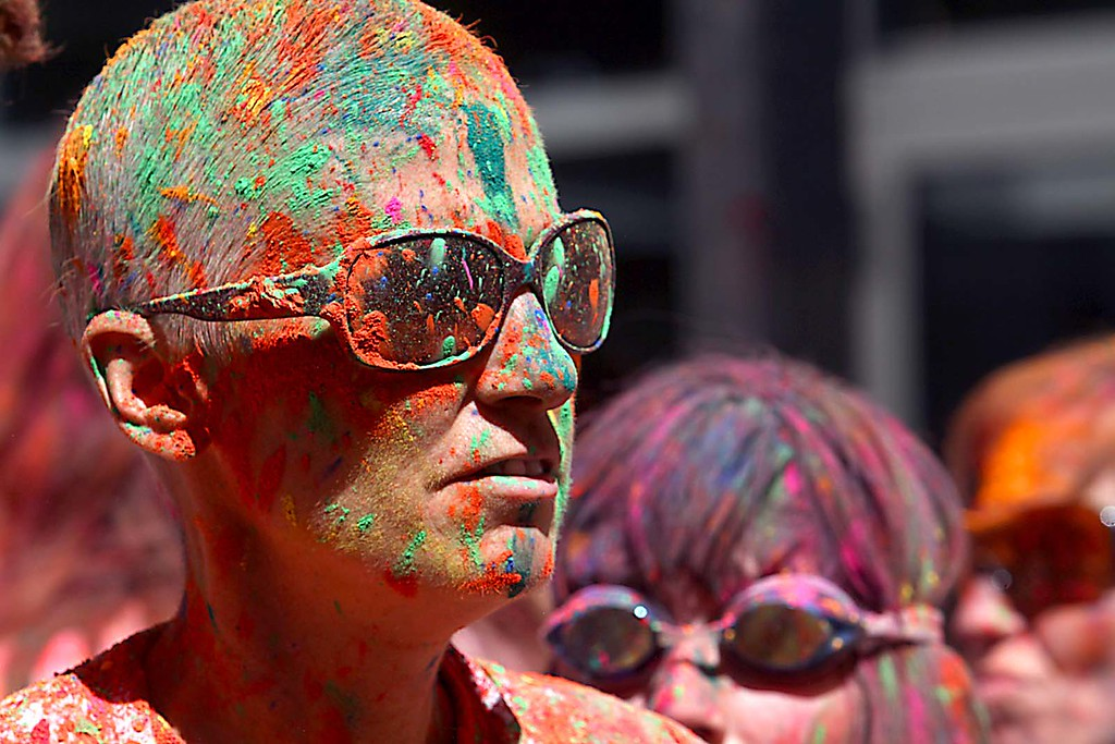 ". Hindu ""Holi\"" festival celebrates the arrival of spring with participants throwing handfuls of colored powder in the air and at each other at the Museum of Art and History in Santa Cruz, Calif., on Saturday, March 30, 2013."