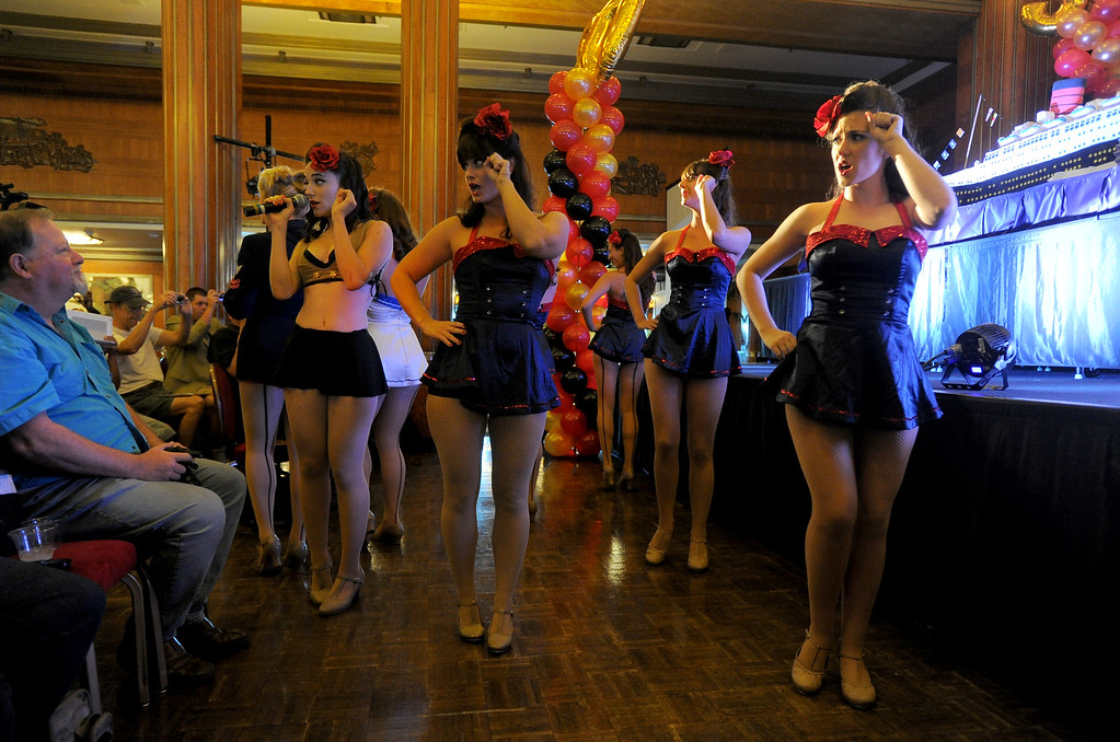 . Pinup song and dance group the Satin Dollz perform at the Queen Mary\'s 80th anniversary of her launching in Long Beach, CA on Friday, September 26, 2014. After some speeches and a short film, guests were able to sample a slice of cake from a 15-foot long, 600-pound replica of the ship made by baker Jose Barajas. (Photo by Scott Varley, Daily Breeze)