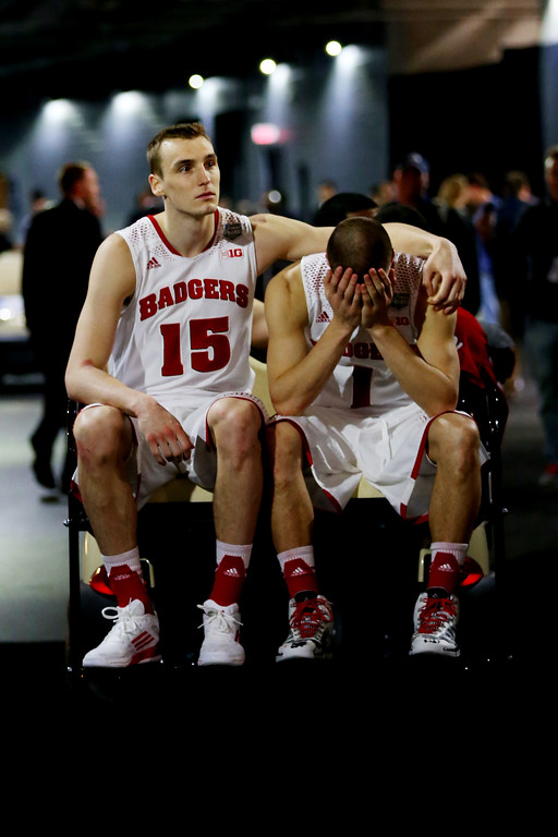 . ARLINGTON, TX - APRIL 05:  Sam Dekker #15 and Ben Brust #1 of the Wisconsin Badgers react after losing to the Kentucky Wildcats 74-73 in the NCAA Men\'s Final Four Semifinal at AT&T Stadium on April 5, 2014 in Arlington, Texas.  (Photo by Ronald Martinez/Getty Images)