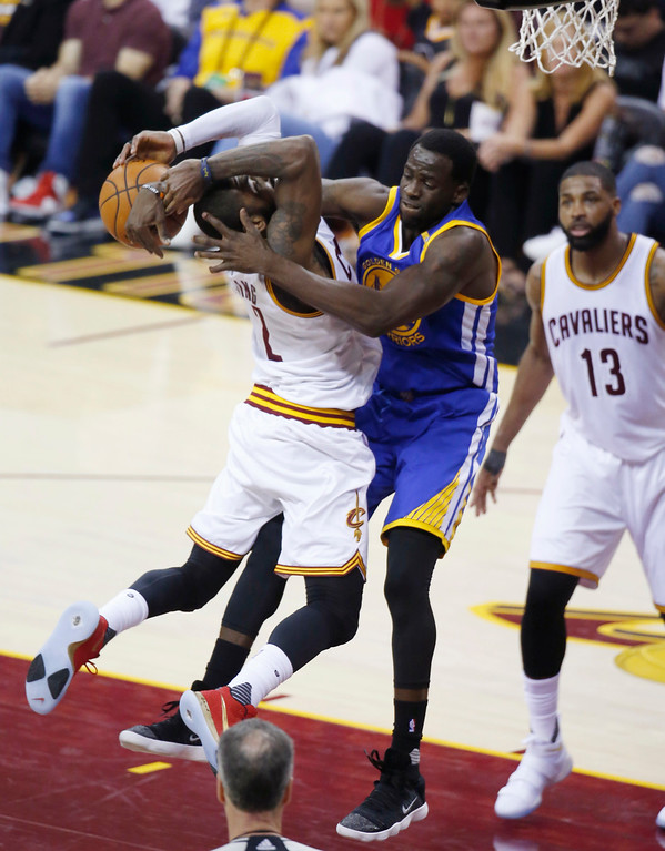 . Golden State Warriors forward Draymond Green (23) defends Cleveland Cavaliers guard Kyrie Irving (2) during the first half of Game 4 of basketball\'s NBA Finals in Cleveland, Friday, June 9, 2017. (AP Photo/Ron Schwane)