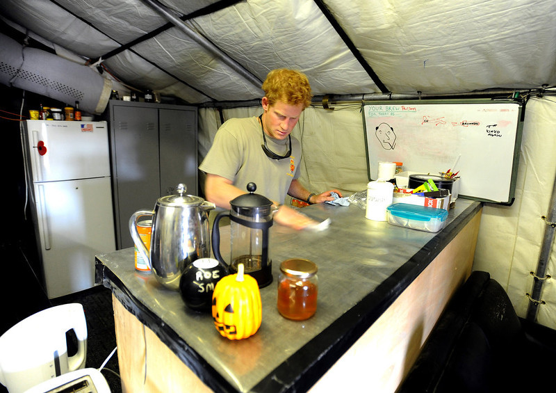 . In this image released on January 22, 2013, Prince Harry cleans the Kitchen work-top during his 12 hour VHR (very high ready-ness) shift at the British controlled flight-line at Camp Bastion on October 31, 2012 in Afghanistan. Prince Harry has served as an Apache Helicopter Pilot/Gunner with 662 Sqd Army Air Corps, from September 2012 for four months until January 2013.  (Photo by John Stillwell - WPA Pool/Getty Images)