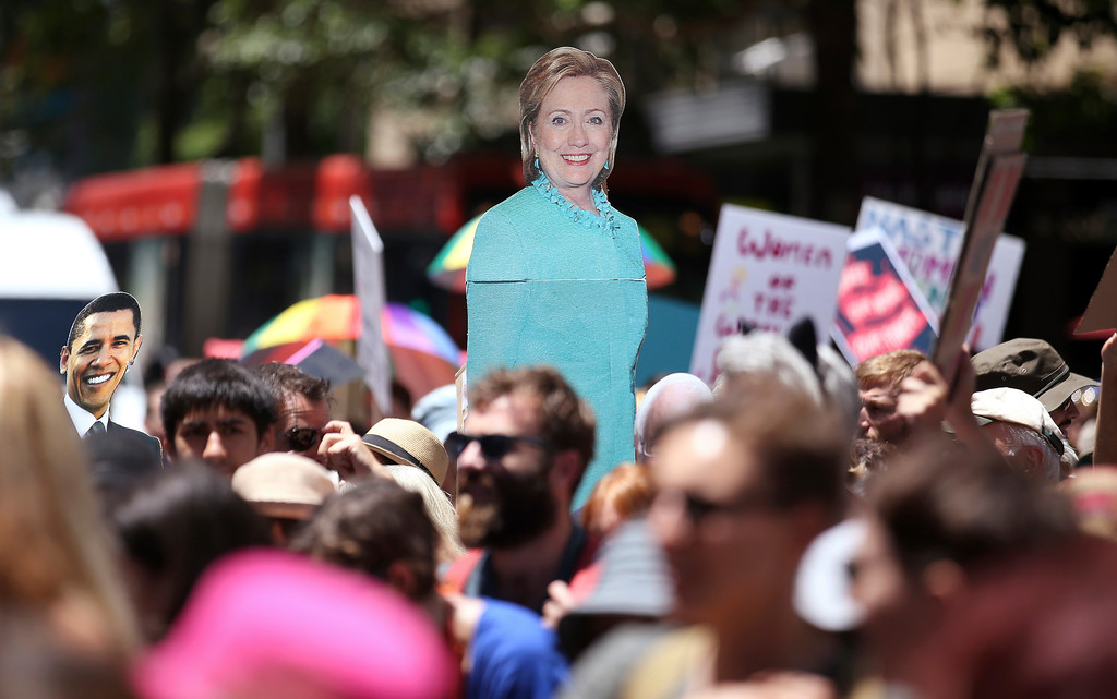 ". Images of Hillary Clinton and Barack Obama are carried as thousands file through the streets during the Women\'s March protesting the start of Donald Trump\'s presidency, in Sydney, Australia, Saturday, Jan. 21, 2017. Protesters at the Women\'s March rally carried placards with slogans including ""Women of the world resist,\"" \'\'Feminism is my trump card\"" and \""Fight like a girl.\"" (AP Photo/Rick Rycroft)"