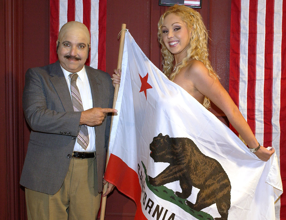 ". Adult film actors Ron Jeremy and Mary ""Mary Carey\"" Cook pose on the set of their adult film \""Run Mary Run,\"" Sunday, Nov. 2, 2003, in Los Angeles. The adult film is based on her actual run for California governor. (AP Photo/Mark J. Terrill)"