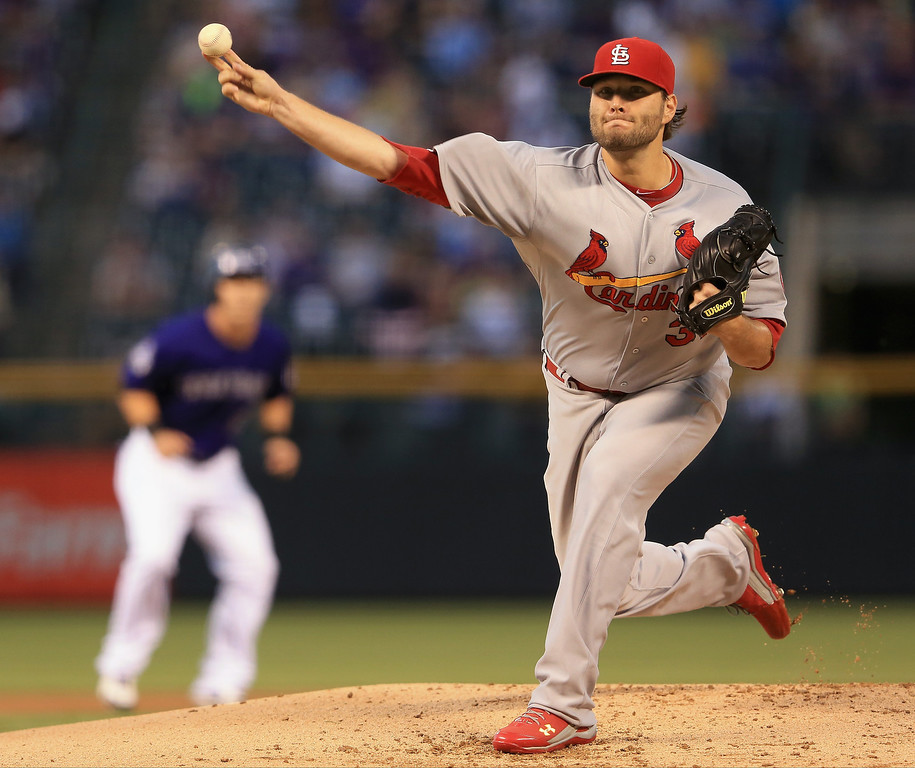 . Starting pitcher Lance Lynn #31 of the St. Louis Cardinals delivers against theColorado Rockies at Coors Field on September 16, 2013 in Denver, Colorado.  (Photo by Doug Pensinger/Getty Images)