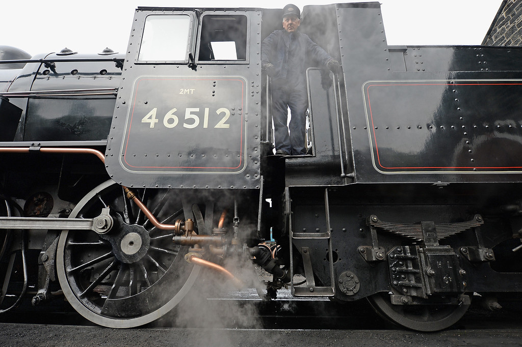 . Fireman Ken Plant looks from the plate of a 1952 British Rail Ivatt number 46512 at Strathspey Steam Railway on August 27, 2013 in Aviemore, Scotland.  (Photo by Jeff J Mitchell/Getty Images)