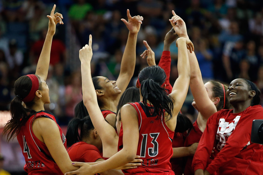 Description of . Members of the Louisville Cardinals celebrate after defeating the California Golden Bears 64-57 to advance to the final round during the National Semifinal game of the 2013 NCAA Division I Women's Basketball Championship at the New Orleans Arena on April 7, 2013 in New Orleans, Louisiana.  (Photo by Chris Graythen/Getty Images)