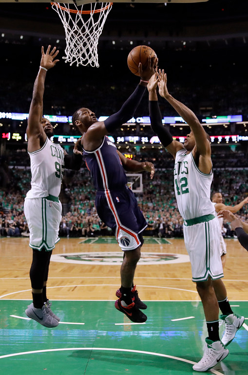 . Washington Wizards guard John Wall, center, drives between Boston Celtics forward Jae Crowder, left, and center Al Horford during the second quarter of Game 7 of a second-round NBA basketball playoff series, Monday, May 15, 2017, in Boston. (AP Photo/Charles Krupa)