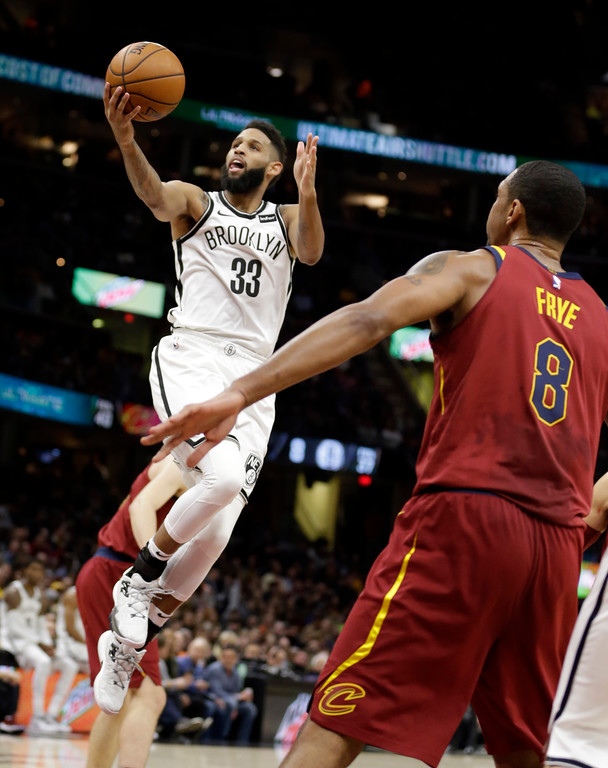 . Brooklyn Nets\' Allen Crabbe (33) drives to the basket against Cleveland Cavaliers\' Channing Frye (8) in the first half of an NBA basketball game, Wednesday, Nov. 22, 2017, in Cleveland. (AP Photo/Tony Dejak)