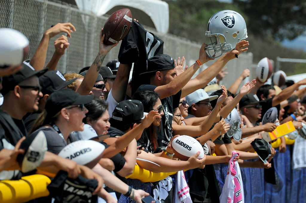 . Raider fans clamor for autographs following the Cowboys-Raiders practice in Oxnard, Wednesday, August 13, 2014. (Photo by Michael Owen Baker/Los Angeles Daily News)