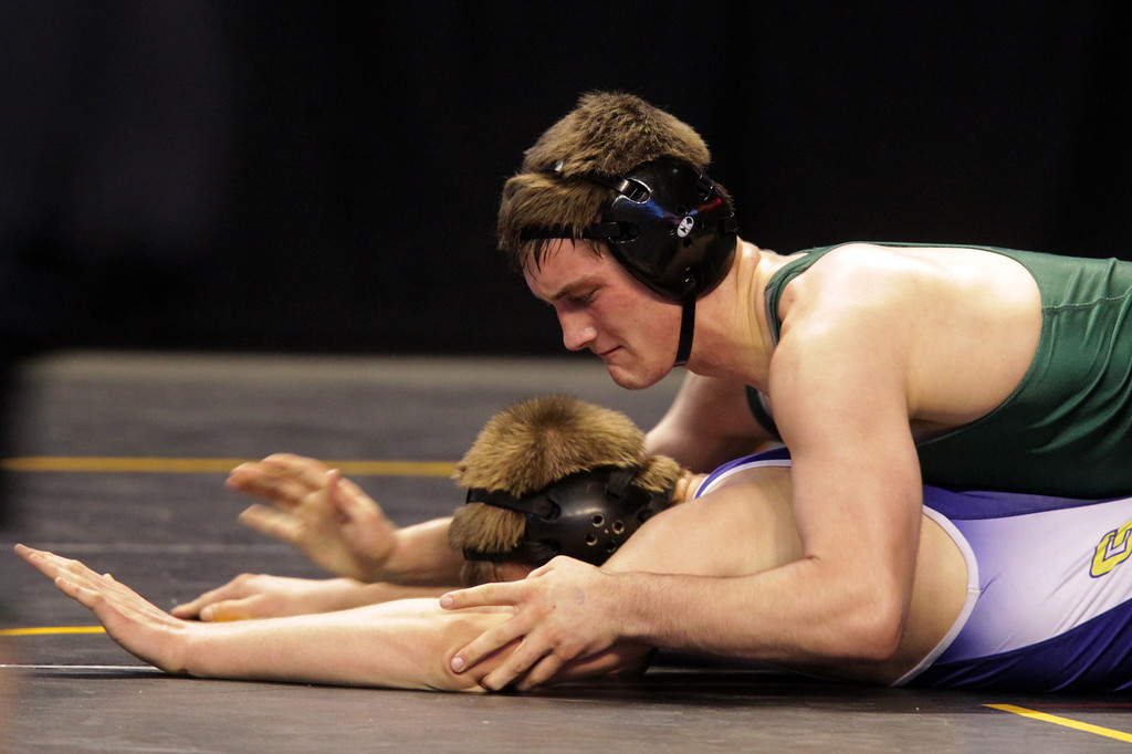 . De La Salle\'s Aaron Pease, top, wrestles Gilroy\'s Mark Penyacsek in a 170-pound second round match during the California Interscholastic Federation wrestling championships in Bakersfield, Calif., on Friday, March 1, 2013. Pease would go on to win. (Anda Chu/Staff)
