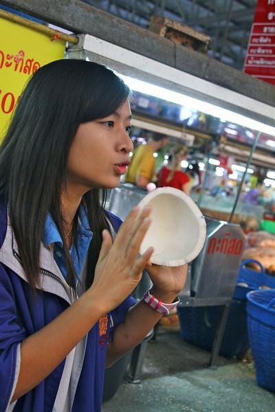 Kook describing how to make coconut cream and coconut milk