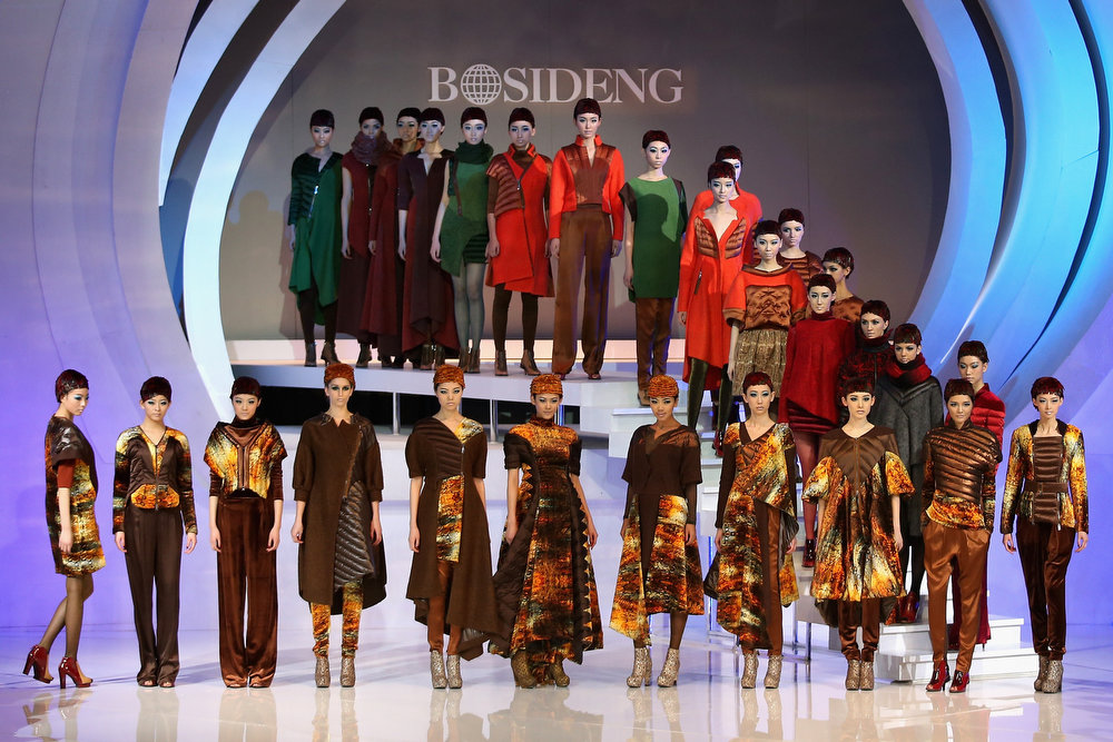 . Models showcase designs on the catwalk during Bosideng Down Wear Collection on the third day of Mercedes-Benz China Fashion Week Autumn/Winter 2013/2014  at 751 D.PARK Workshop on March 26, 2013 in Beijing, China.  (Photo by Feng Li/Getty Images)