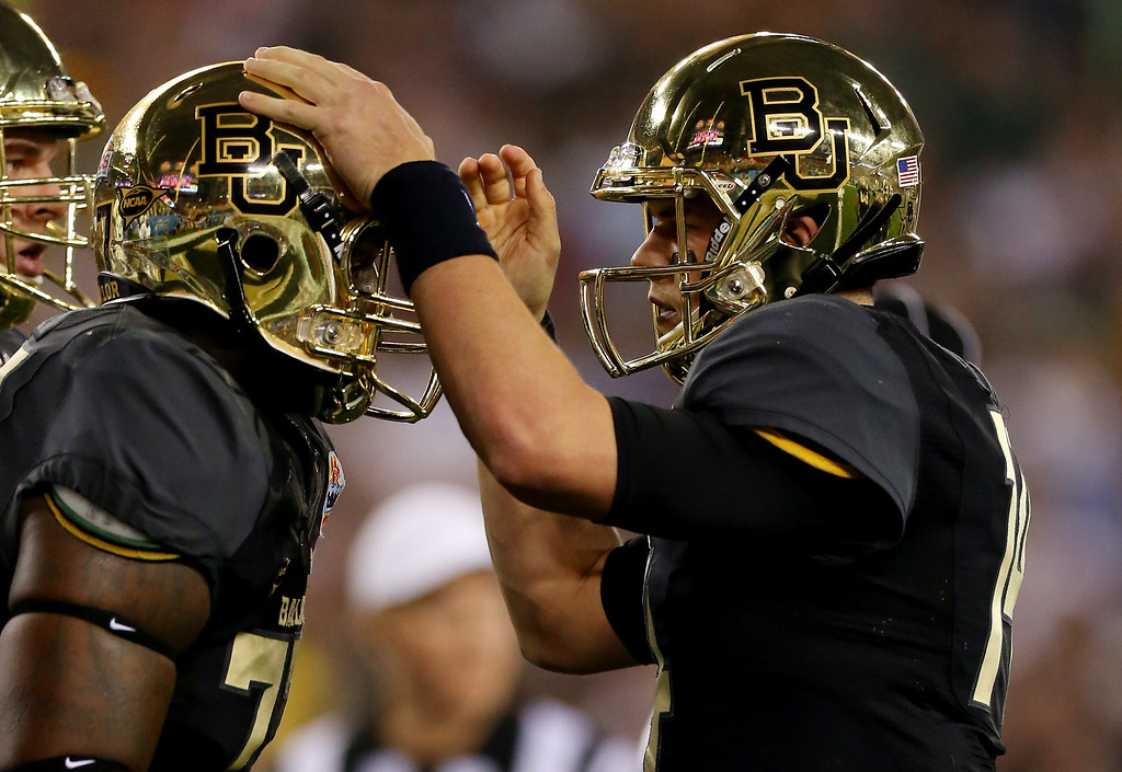 . GLENDALE, AZ - JANUARY 01:  Quarterback Bryce Petty #14 celebrates a touchdown with offensive linesman Kelvin Palmer #77 of the Baylor Bears against the UCF Knights during the Tostitos Fiesta Bowl at University of Phoenix Stadium on January 1, 2014 in Glendale, Arizona.  (Photo by Ronald Martinez/Getty Images)