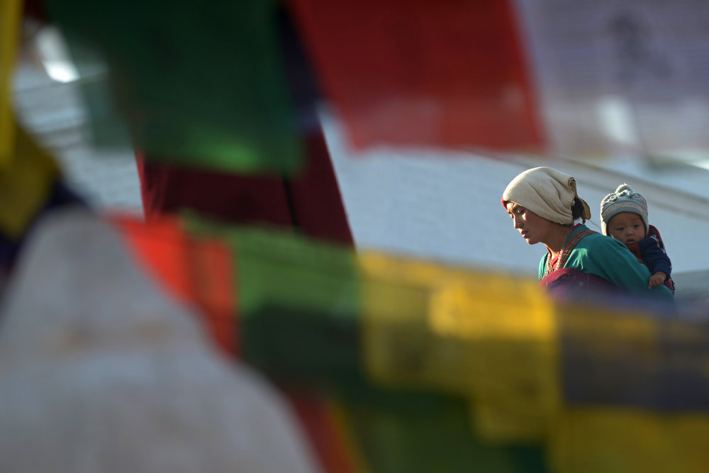 . A Buddhist devotee circumambulates the Boudhanath Stupa - close to where a monk self-immolated later in the day against Chinese rule in Tibet - on the third day of Losar, the Tibetan new year, in Kathmandu on February 13, 2013. A Tibetan monk doused himself in petrol in a Kathmandu restaurant on Wednesday and set himself on fire, marking the 100th self-immolation bid in a wave of protests against Chinese rule since 2009. PRAKASH MATHEMA/AFP/Getty Images